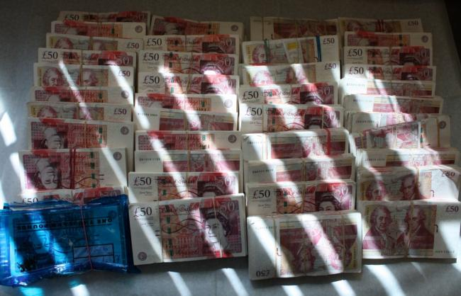 Cash haul: some of the notes seized by officers