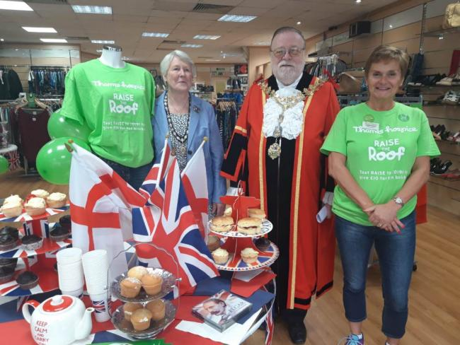 Flying the flag: Uxbridge shop volunteers were joined by the mayor