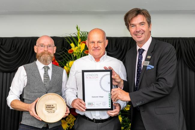 In bloom: Paul Richards and Stuart Hunt collect the Eastcote Village award