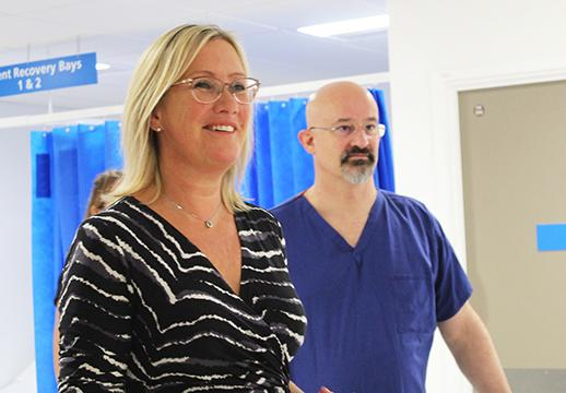 First hand: Caroline Dinenage, seen with consultant surgeon Andre Simon, is given a tour