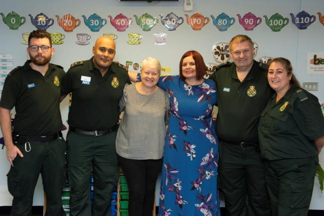Reunited: Rachael (blue dress) and life-saver Judy with some of the medics who attended