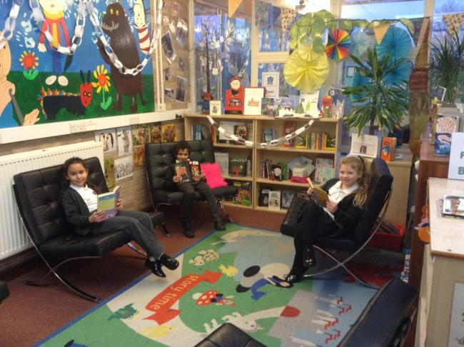 School pupils sitting in the donated chairs in the library
