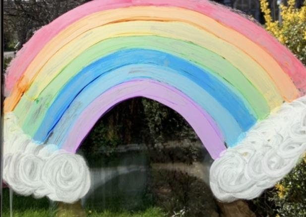 A picture of a rainbow in a window by Zoe as she asks people to stay safe. Photo: Zoe F