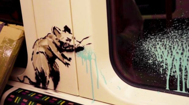 Hillingdon Times: Banksy's sneezing rat reminds us of the dangers of passing on the virus on public transport (Photo: Banksy).