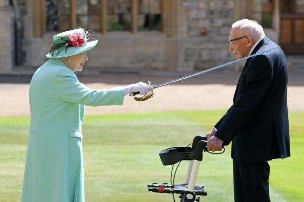 Hillingdon Times: Capt Sir Tom is knighted by the Queen
