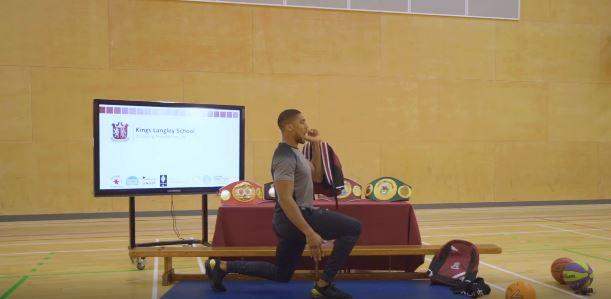 Hillingdon Times: Anthony Joshua showing pupils a workout (photo Kings Langley School)