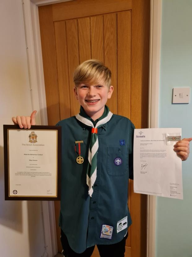 Hillingdon Times: Rhys Hanson with his honour. Credit: Rickmansworth and Chorleywood Scouts