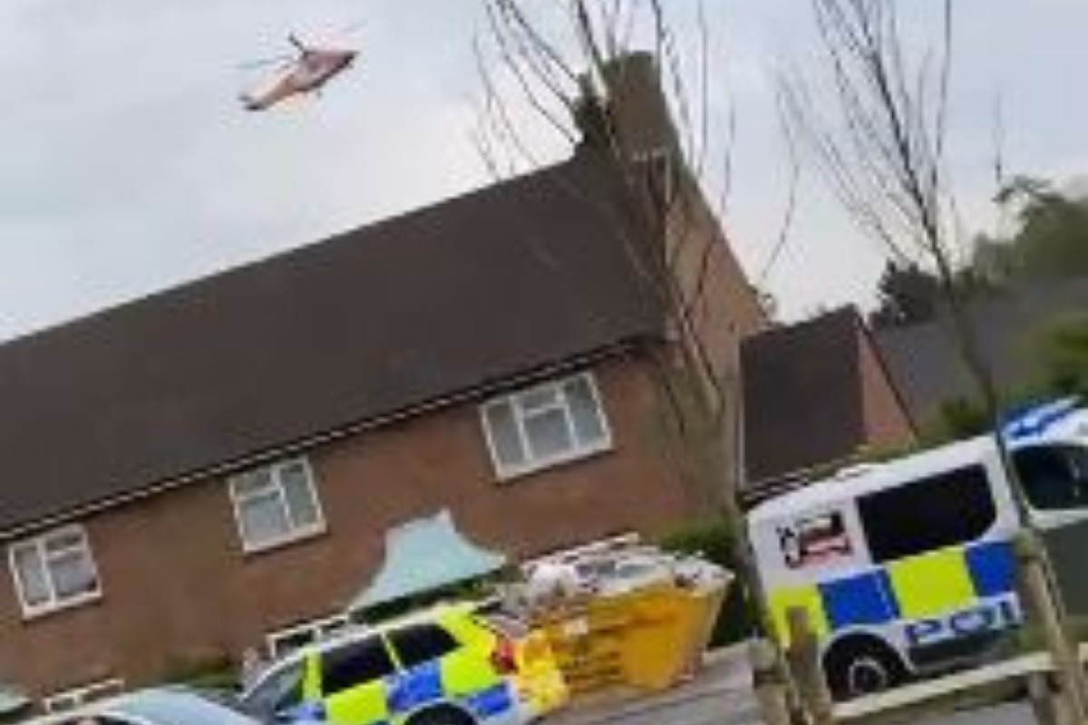 A helicopter can be seen landing close to the scene of where a teenager was found injured