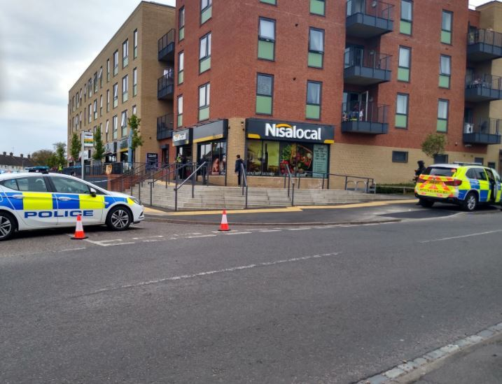 Police outside the shops in The Brow