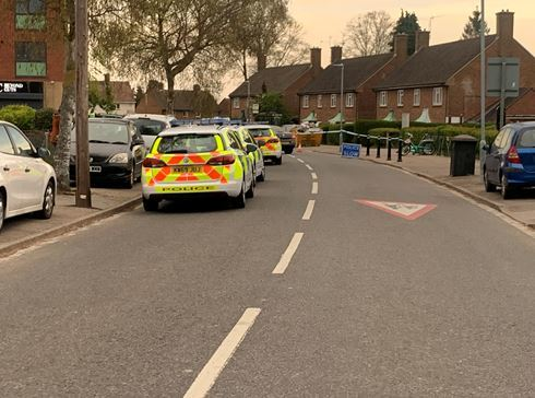 A row of police vehicles in The Brow near the junction with Louvain Way