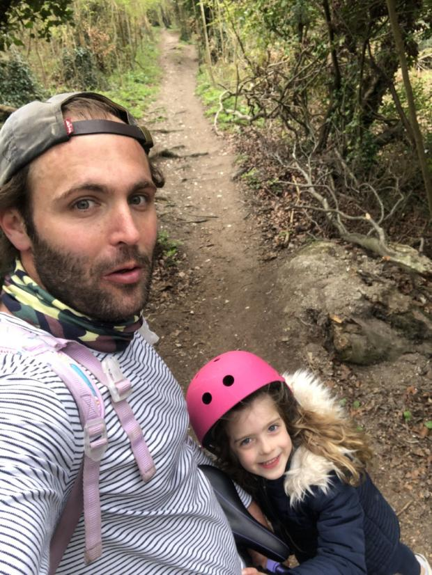 Hillingdon Times: Rob taking his daughter Ava on a bike ride