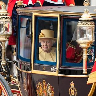 The Queen leaves Buckingham Palace to attend the Trooping the Colour parade