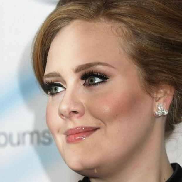 Adele's album 21 took the top place in a chart of the biggest selling digital albums ever