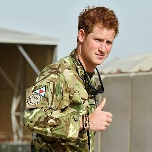 Prince Harry gives a thumbs-up at Camp Bastion in Afghanistan