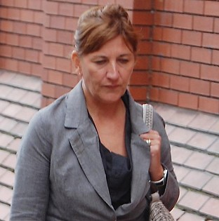 Karen Cosford arrives at Leeds Crown Court, where she is accused of having sex with a convicted rapist at Wakefield Prison