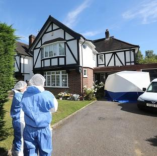 Hillingdon Times: Forensic officers outside the home of the French shooting victim in Claygate, Surrey