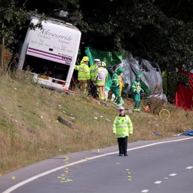 Hillingdon Times: Emergency services at the scene of a coach crash on the A3 near Hindhead in Surrey