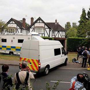 Police and the media outside the home of Saad Al-Hilli in Claygate, Surrey