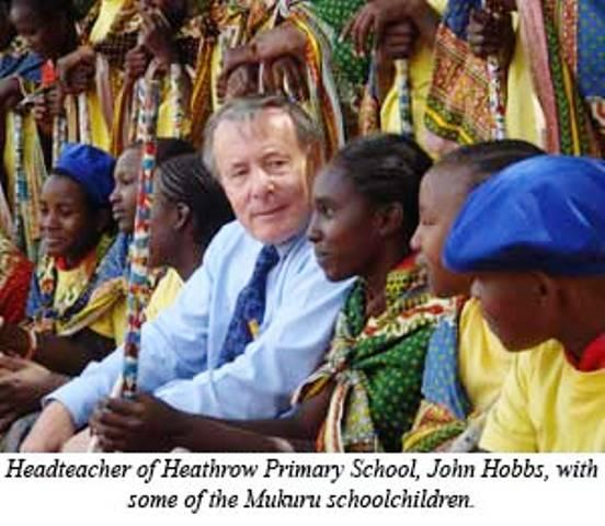 Long links: former Heathrow head John Hobbs with some of the community his school is helping