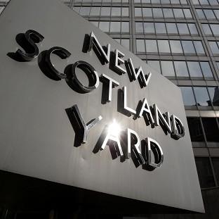 Scotland Yard said the man was detained on suspicion of conspiracy to corrupt and suspicion of conspiracy to cause misconduct in a public office