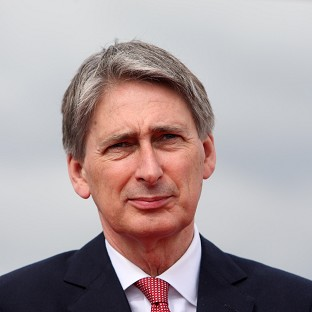 Philip Hammond has welcomed an announcement by ISAF that Nato forces are scaling back joint operations with Afghan forces