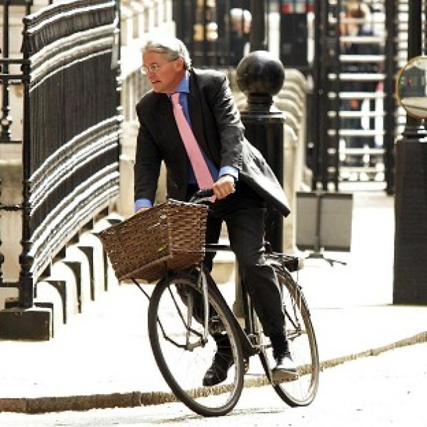 Hillingdon Times: Andrew Mitchell exchanged words with police on Downing Street when he tried to leave on his bicycle