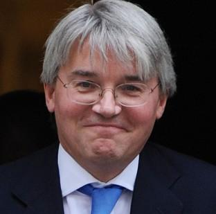 Andrew Mitchell apologised for an outburst at officers who stopped him cycling through the main gates of Downi
