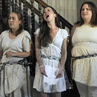 Activists from the Occupy movement stage a protest by chaining themselves to the pulpit in St Paul's Cathedral, London