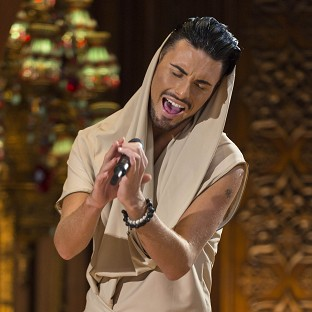 X Factor finalist Rylan Clark has moved out of the hotel following a 'naughty' night out with Lucy Spraggan