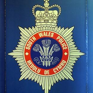 South Wales Police officers have arrested a man in connection with several road traffic collisions