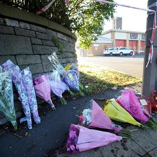 Floral tributes outside the Fire Station in Cardiff where Karina Menzies was killed in a hit-and-run incident