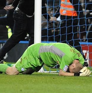 Sheffield Wednesday goalkeeper Chris Kirkland after being struck by Aaron Cawley (EMPICS Sport)