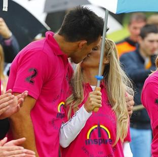 Katie Price kisses now ex-boyfriend Leandro Penna at Tidworth Polo Club near Salisbury, Wiltshire