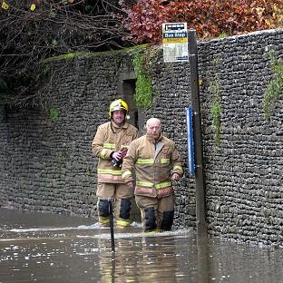 A man has died in his car during flooding in Somerset