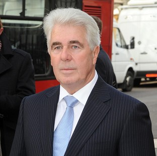 Publicist Max Clifford was held at his Surrey home by police, according to sources