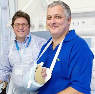 Hand transplant patient Mark Cahill (right) with Professor Simon Kay at Leeds General Infirmary