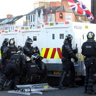 A police officer is injured after loyalist protesters attacked police lines at the Albertbridge Road near the nationalist Short Strand area of Belfast