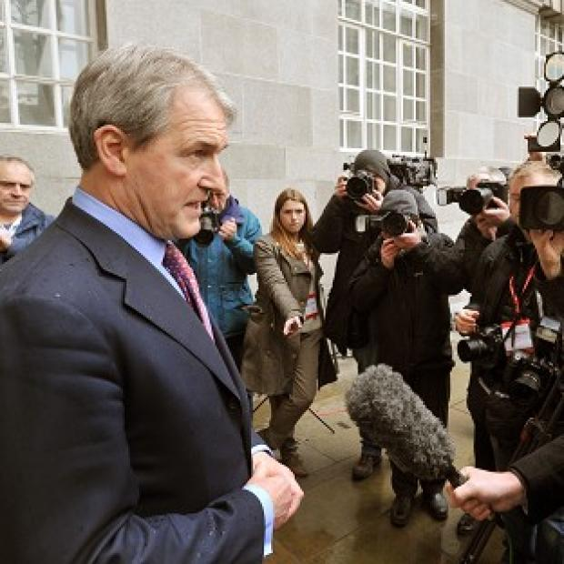 Owen Paterson speaks to the media outside Defra Headquarters in London after meeting with representatives of the food industry