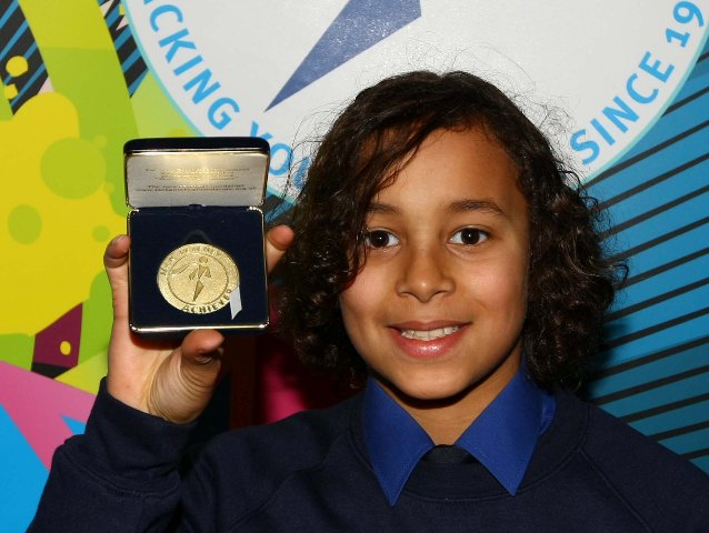 Bright-eyed: Luke with his Petchey Award