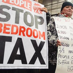 Hillingdon Times: Protestors take part in a demonstration outside Croydon Town Hall in Surrey, against the government's proposed 'bedroom tax'