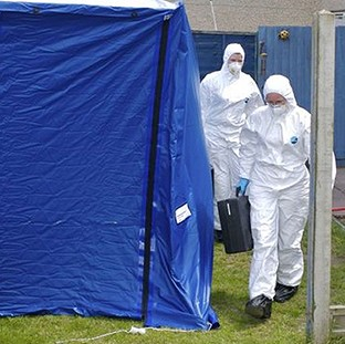 Forensic officers at the scene in Birmingham where a 15-year-old boy was stabbed to death