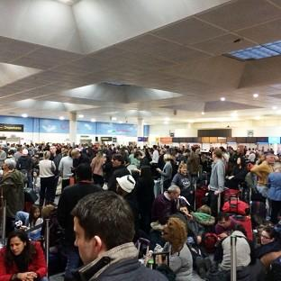 Passengers waiting at the North Terminal at Gatwick as flights were cancelled due to bad weather (Daniel Cawthorne).