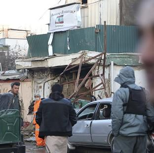 Afghan security forces investigate the suicide attack in Kabul, Afghanistan (AP)