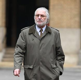 Hillingdon Times: Former DJ Dave Lee Travis arrives at London's Southwark Crown Court, where he is accused of a series of indecent assaults and one sexual assault