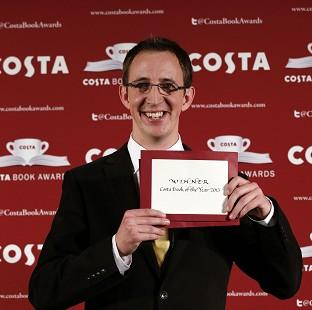 Hillingdon Times: Nathan Filer accepts the 2014 Costa Book Award for his novel 'The Shock of the Fall' at Quaglino's, London.