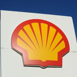 Royal Dutch Shell has reported a 48% slide in profits