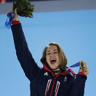 Hillingdon Times: Lizzy Yarnold celebrates during the medals ceremony at the Winter Olympics (AP)