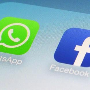 Facebook hopes that its purchase of WhatsApp will help the instant messaging service reach a billion people (AP)