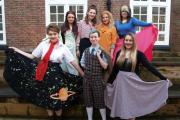 Uxbridge College students have won grants of £7,000 to develop a company which styles its clients in vintage costumes, make-up and hair