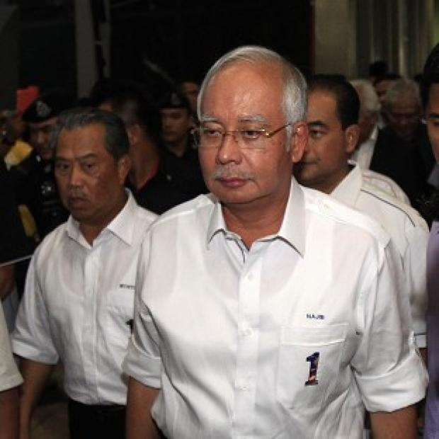 Hillingdon Times: William Hague has offered UK help to Malaysian PM Najib Razak and authorities investigating a missing flight. (AP Photo/Lai Seng Sin)
